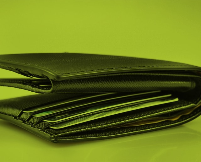 Wallet on green background